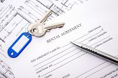 pic of rental agreement  - Rental agreement document with keys and pencil - JPG