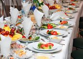 picture of catering  - tables set for fine dining during a wedding event. Shallow depth of field.