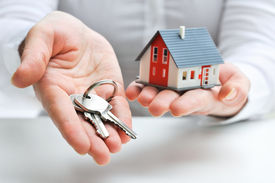 foto of possession  - Real estate agent with house model and keys - JPG