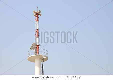 Warning tower tsunami on blue sky.
