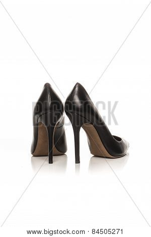 Black Women's Shoes On A White Background