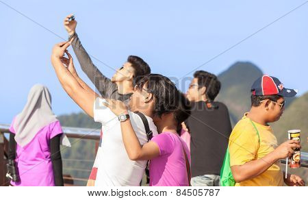 Tourists Taking Selfie Pictures.