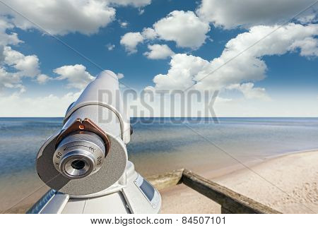 Telescope On A Beach Pointed At Beautiful Sky.