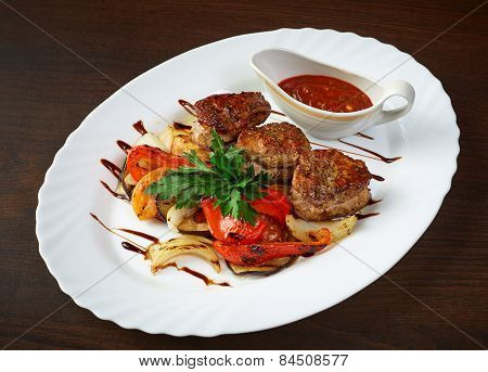 Meat cutlets with roasted vegetables and sauce