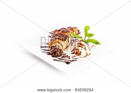 Croissant With A Scoop Of Ice Cream Chocolate Syrup