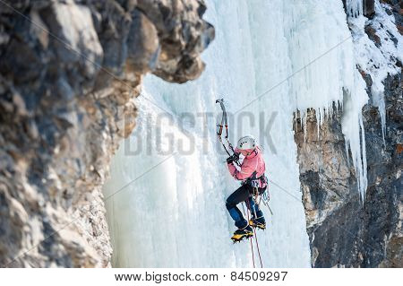 Mountaineer Ascends The Vertical Icefall With Ice Picks