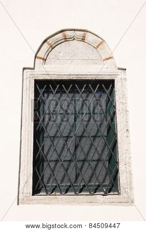 Wooden Window With Metal Grille