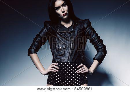 Serious Brunette Woman In Black Jacket
