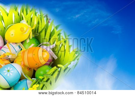 Green Grass Box Of Easter Eggs On The Blue Sky With Clouds Background