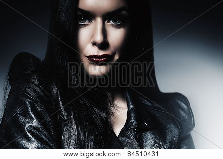 Sexy Woman With Red Lips In Black Jacket