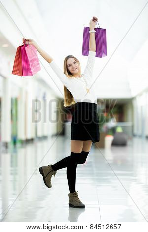 Glad Young Woman Dancing With Shopping Bags