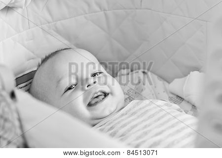 Cute  Baby Smiling Looking At The Camera