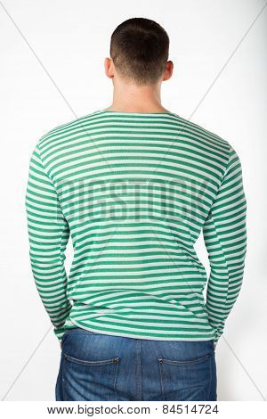 Slender young man in a turquoise sweater