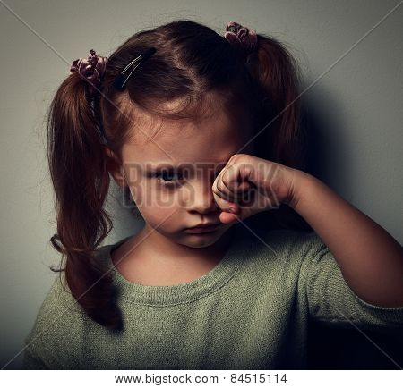 Unhappy Crying Kid Girl In Darkness. Closeup Vintage Portrait