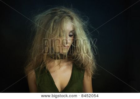Young Beautiful Woman With Disheveled Curly Hair