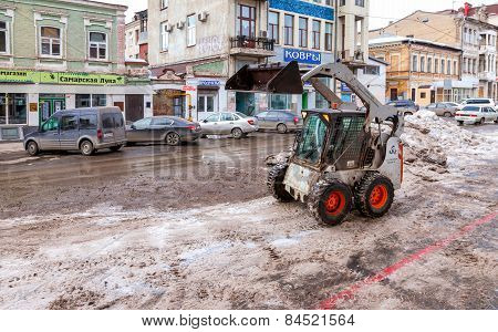 Tractor Cleaning The Streets Of City From Snow And Ice After The Heavy Snowfall