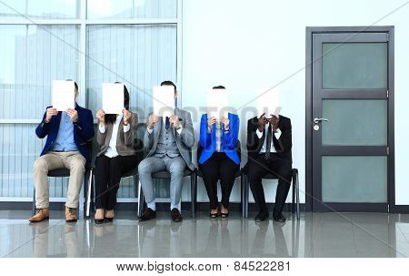 Human resource concept, Young businessman holding white billboard and waiting for job interview