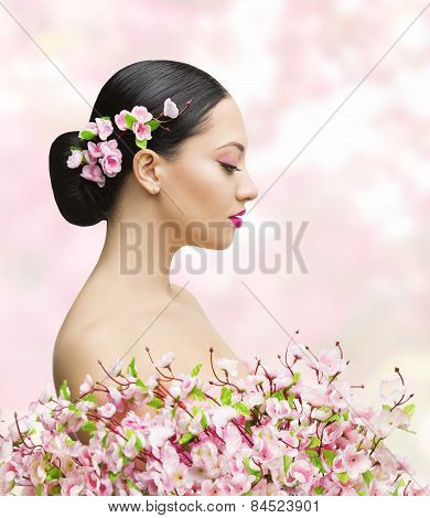 Woman Beauty Portrait In Sakura Flower, Asian Girl Bun Hairstyle, Beautiful Model, Pink Background