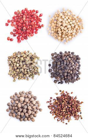 Different Kinds Of Pepper On A White Background