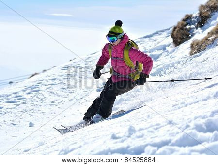 Woman skier in the soft snow, downhill skiing