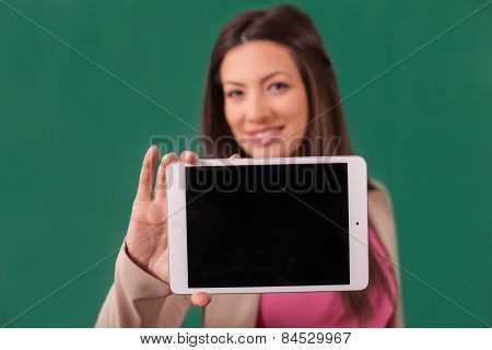 Beautiful Woman Showing A Tablet