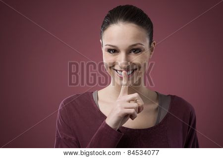 Young Woman Telling A Secret