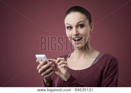 Surprised Young Woman Using Mobile Phone