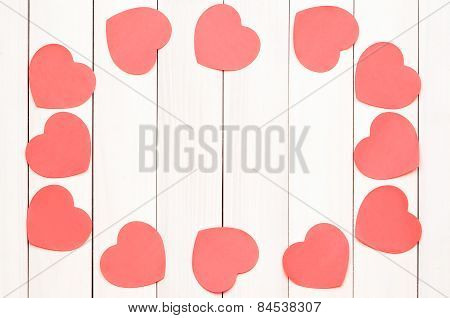 Red heart stickers on a light wooden background