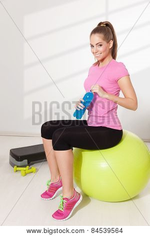Woman With Drink During Workout