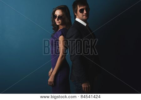 Perfect spy couple man and woman in glasses  standing posing.