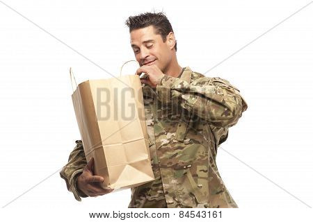 Happy Army Soldier Looking Into His Shopping Bag