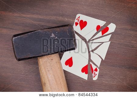 Hammer With A Broken Card, Four Of Hearts