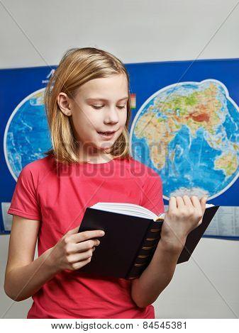Girl Reading Book Near Map
