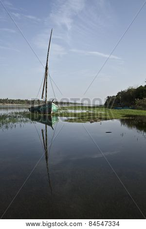 A sailing boat sits idle on the Nile flood plain