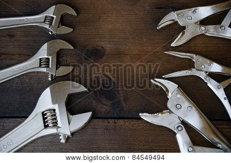 Adjustable wrench or spanner wrench and Locking pliers on wooden background, Prepare basic hand tool