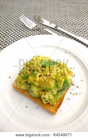 Scrambled Egg with Avocado and Toast Bread