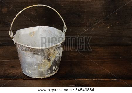 Paint cans or paint bucket on wooden background.