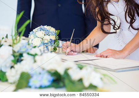 Bride Signing Wedding License