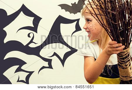 Portrait of a pretty little blonde girl with a Halloween style