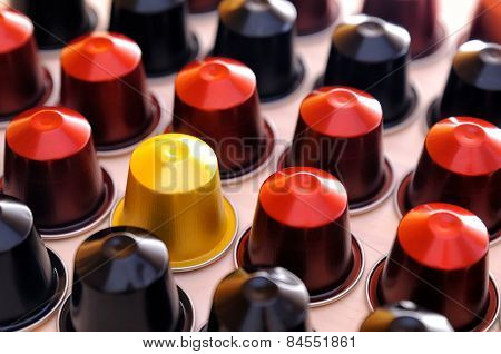 Set Of Espresso Coffee Capsules Aligned Diagonally