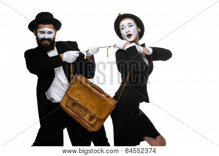 Business Man And Woman Fighting Over Briefcase