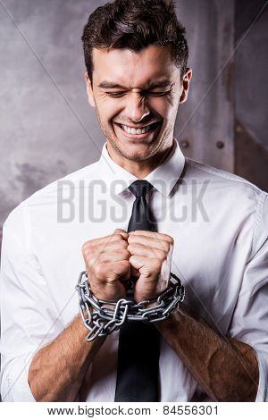 Businessman Trapped In Chains.