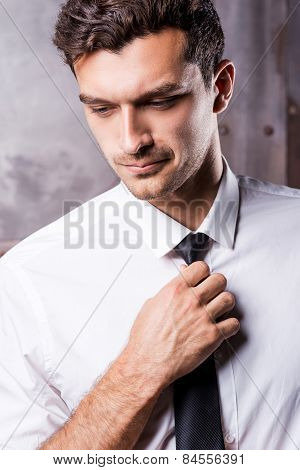 Adjusting His Necktie.