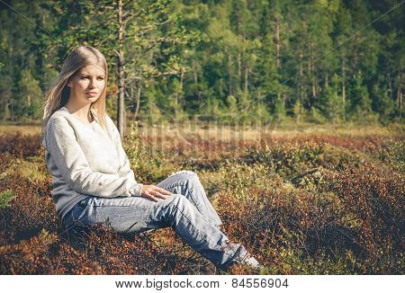 Young Woman sitting alone walking outdoor Travel Lifestyle