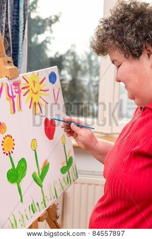 Mentally Disabled Woman Painting A Picture