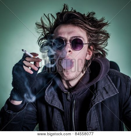Punk Guy With Glasses Smoking Cigaret