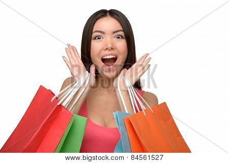 Asian cheerful woman after shopping with bags