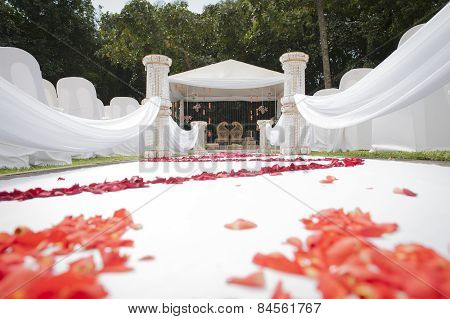 white wedding service decor with rose petals