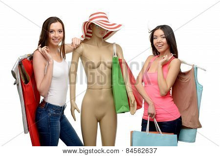 Two women after shopping with bags and mannequin