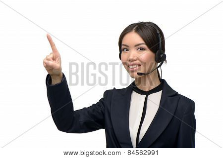 Asian call center female operator pointing at something
